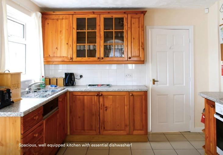 spacious well equipped kitchen with essential dishwasher