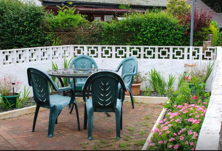attractive back patio with garden furniture-great for outdoor meals