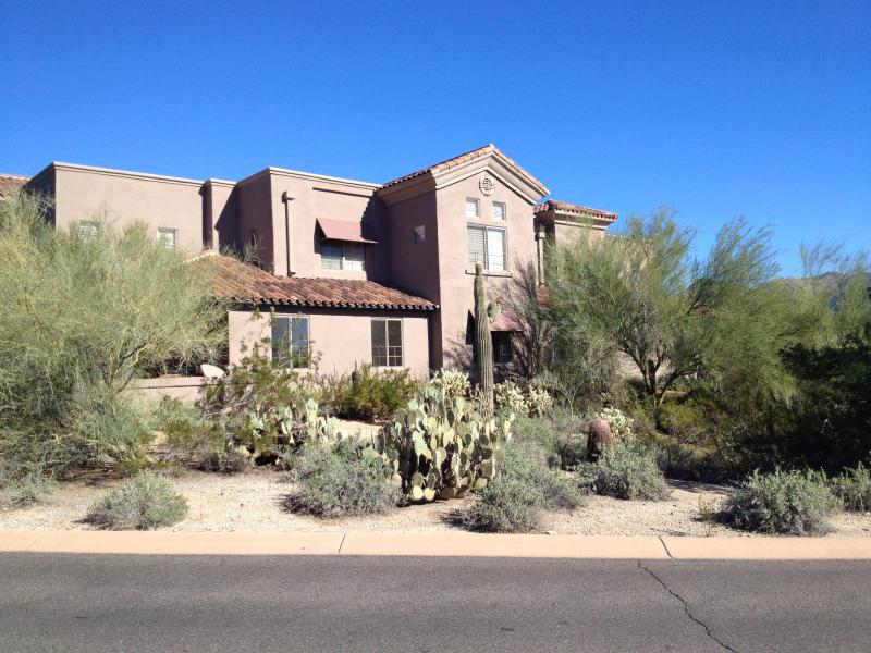 Our home is on ground floor right of photo--quiet, desert setting, patios, amazing sunsets