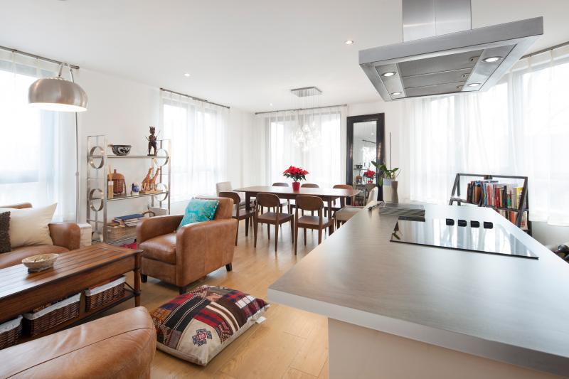 Spacious living room with panoramic windows/views