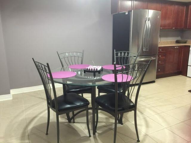 open concept kitchen with a 4 seat table and  2 high chair