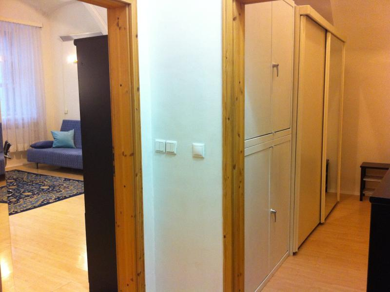 Store room with wardrobe, shoe-bench, vacuum cleaner, guests can leave their luggage here