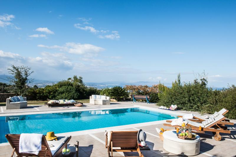 Villa Mariposa - Private spacious pool area with panoramic sea and city view.