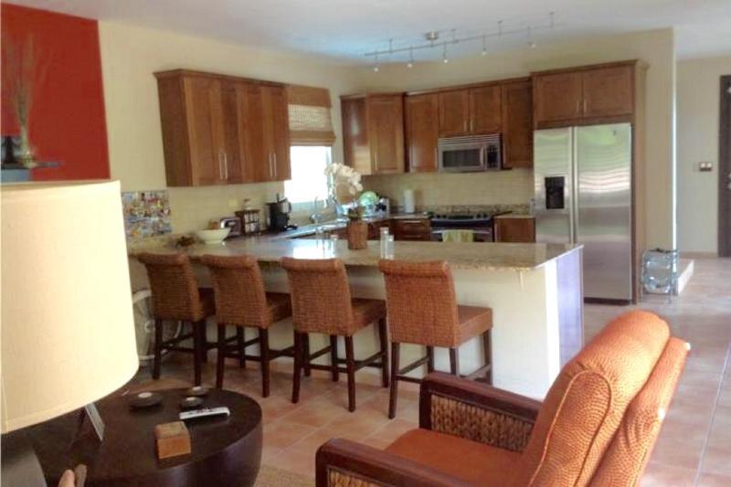 Kitchen with stainless steel appliances and living room