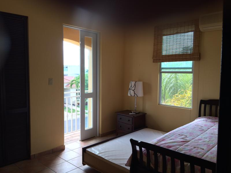 Bedroom 3 with twin size bed (2 mattresses) with window, AC and balcony overlooking the south