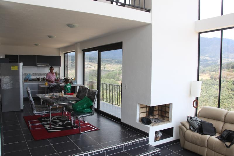 Dinning room, fire place, first floor balcony and kitchen