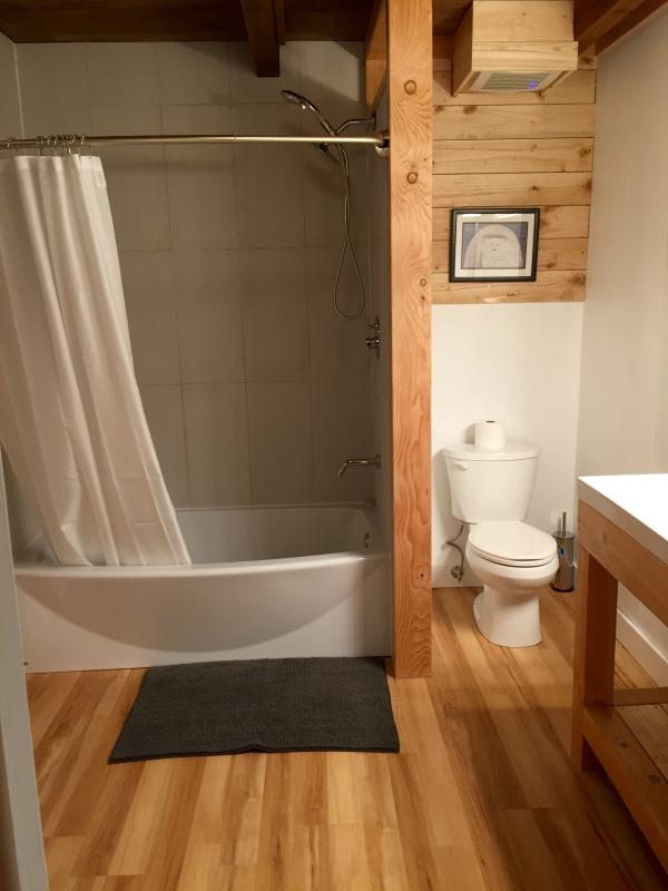 Brand new bath tub with extra elbow room.