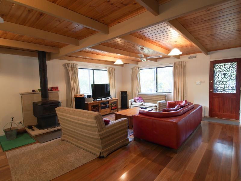 Lounge room with ample seating and Coonara wood stove