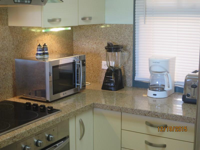 Kitchen with Blender, Microwave, Coffee Maker and Toaster
