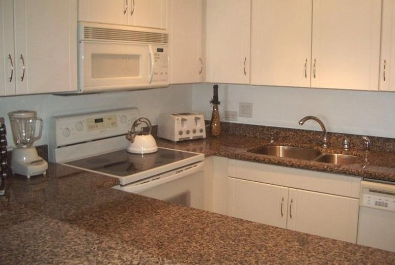Well stocked new custom made kitchen, with granite counter tops
