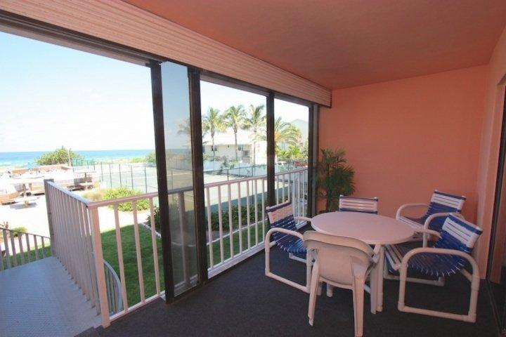 Private Patio overlooking the Heated Pool/Tennis Courts and Amazing Gulf View-Patio Seating for 4-6