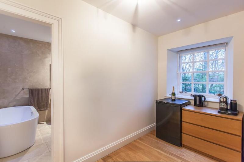 Kitchenette/dressing room.  Comprises fridge, kettle, microwave, Nespresso, iron, hairdryer, linen.