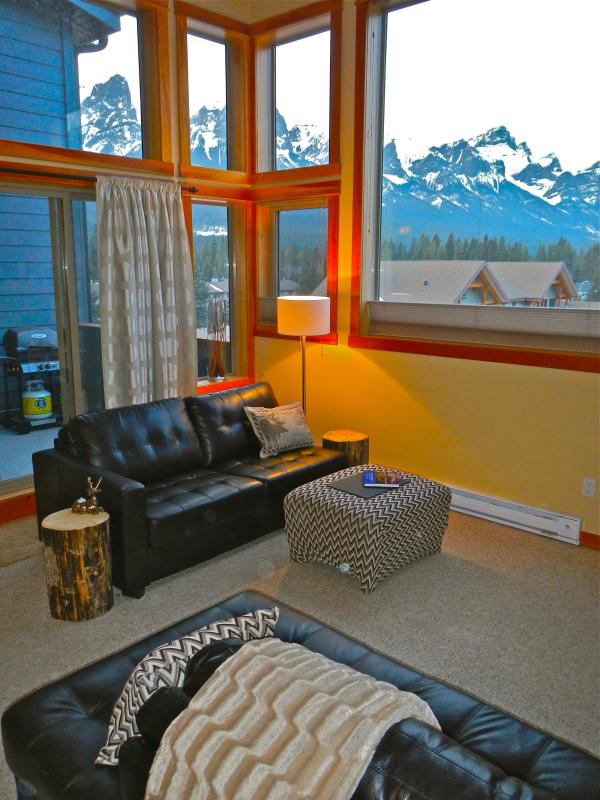 Two story panoramic window looking west to Banff National Park.  Views of the Rundle & Cascade Mtn.