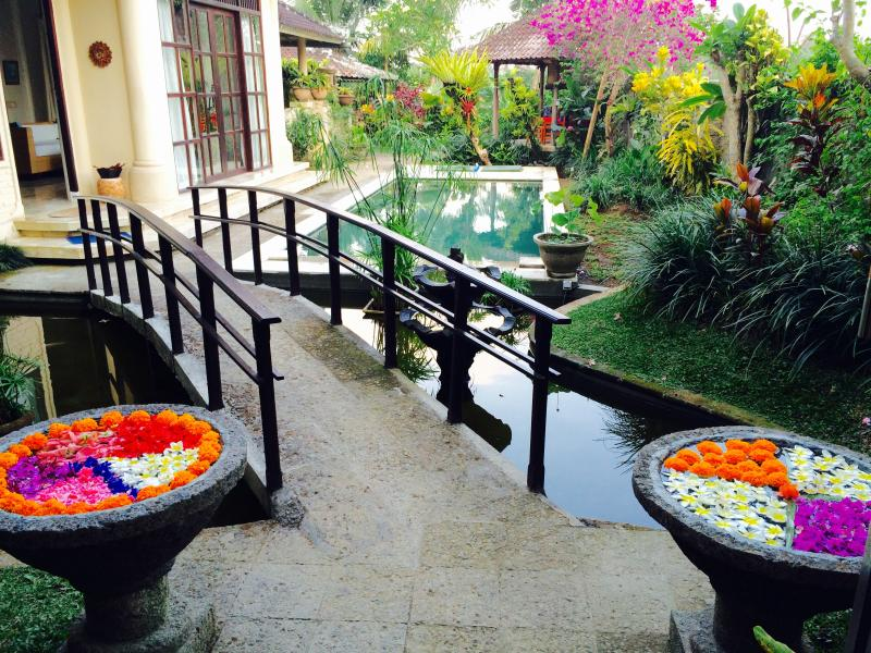 Welcome entrance a 'Bridge over Koi' and into our tropical garden.