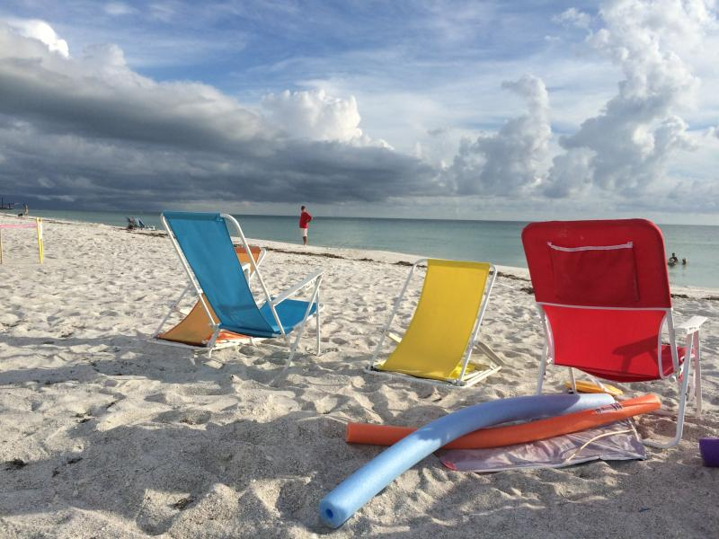 We provide beach chairs/toys and unbrellas