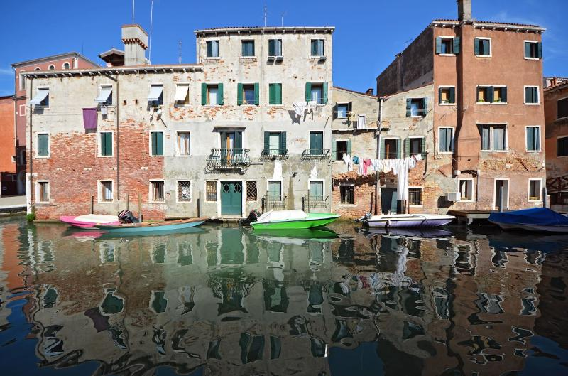 enjoy the charming view from the Miranda apartment on antique buildings reflected on the calm waters