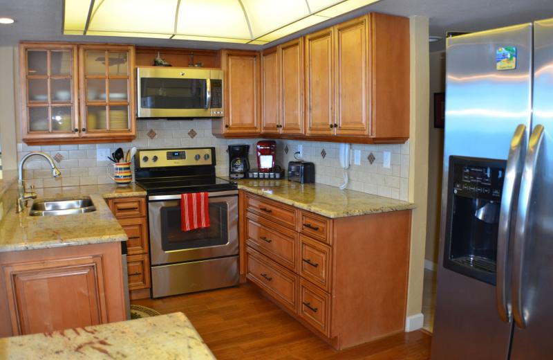 Updated kitchen fully furnished with dishware and cookware