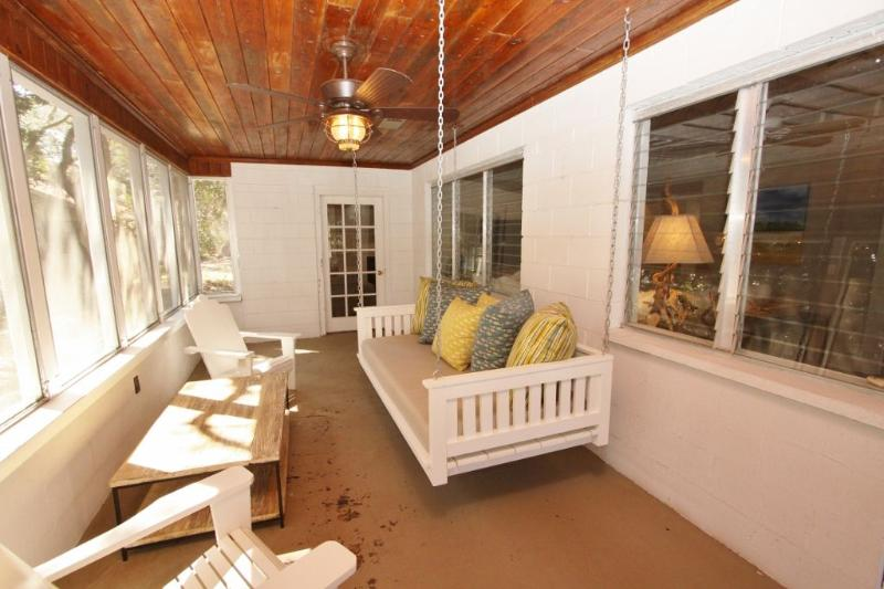 Screened Porch Also Has Adirondack Chairs