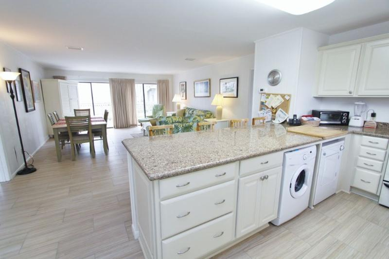Breakfast Bar Overlooks Living and Dining Areas