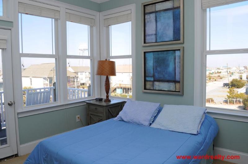 2nd Floor Streetside Bedroom with a Queen Bed