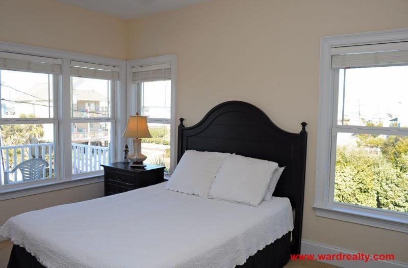 1st Floor Streetside Bedroom with a Queen Bed