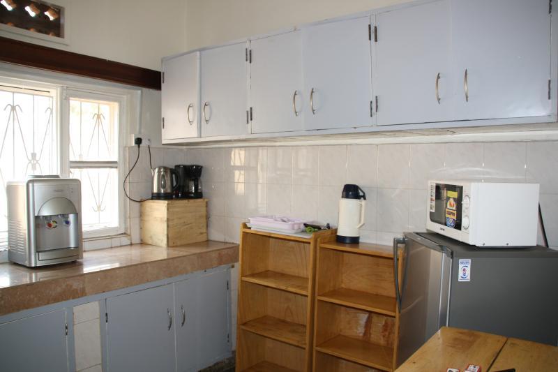 kitchen with plenty of storage , appliances and utensils