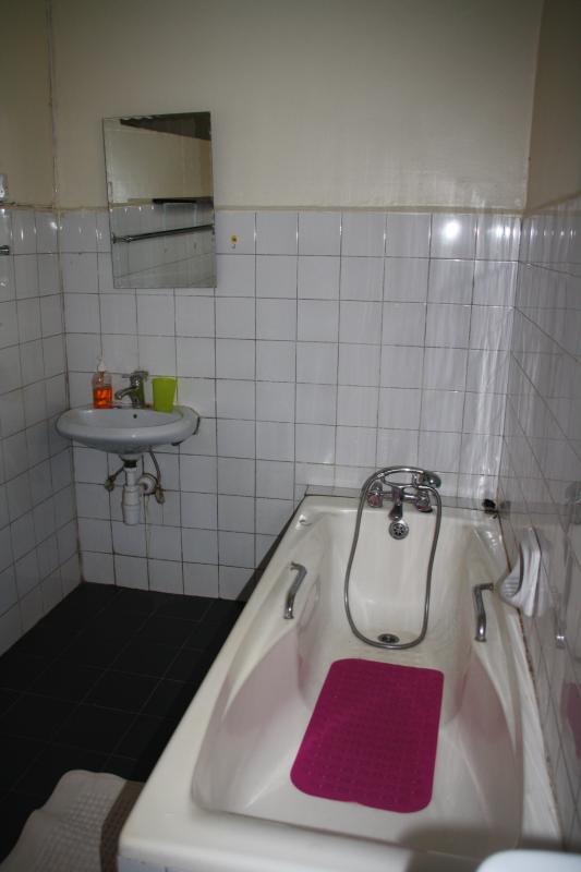 room 1 bathroom with tub