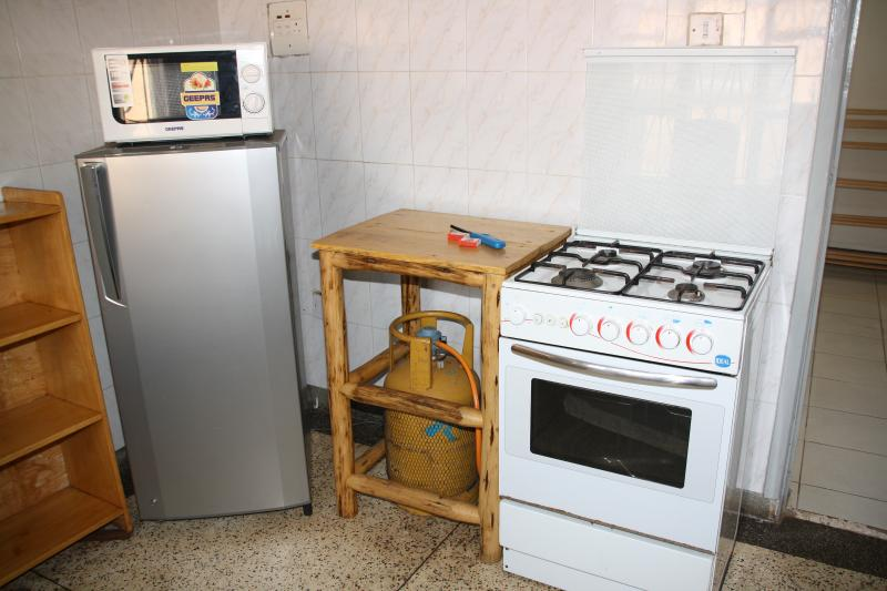 kitchen with gas stove and fridge