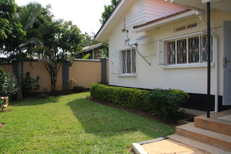 4 bedroom 2 bath house with well maintained garden ,gazebo in quiet residential area.