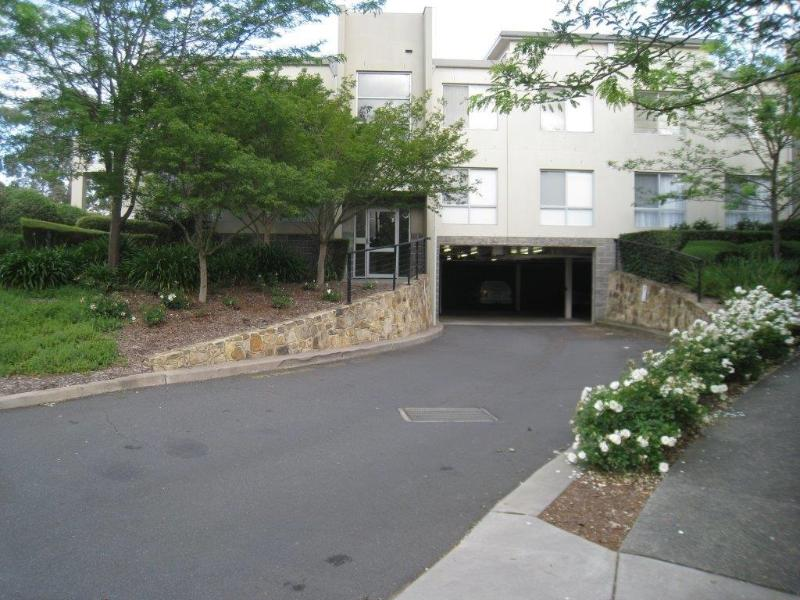 Driveway to guest car spaces and swipe card entry to gated apartment car spaces