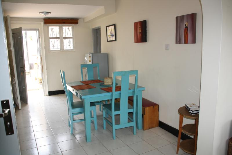 dinning area with extra fridge and bench for extra seating
