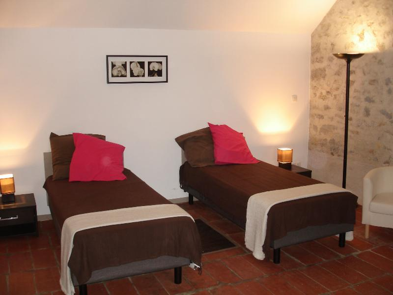Room with 2 single beds made for your arrival