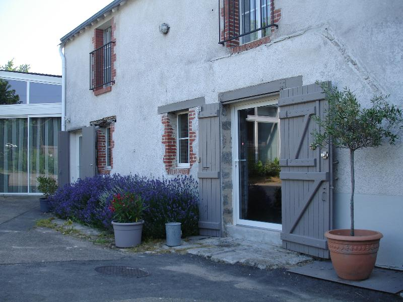 Part of the facade of the cottage with Lavender in flower.