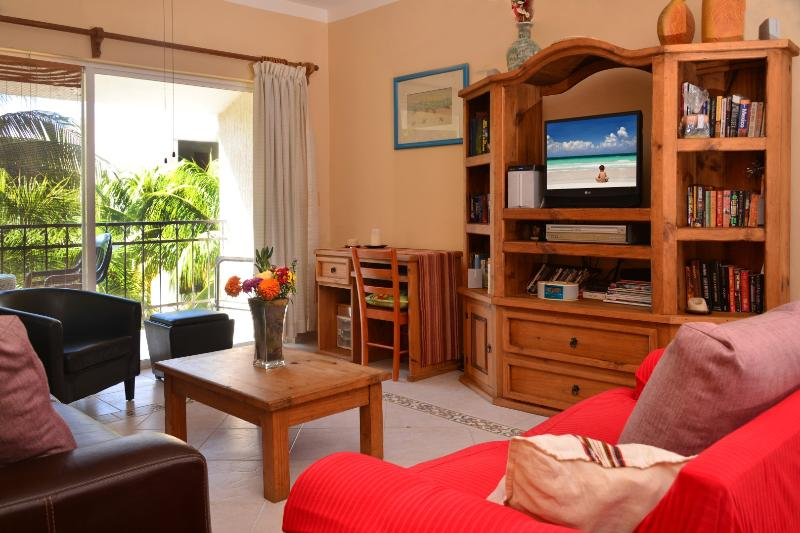 balcony access from the comfortably furnished living area