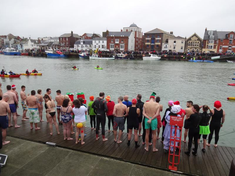Watch the Christmas Day Harbour Swim or join in and earn your Christmas pudding!