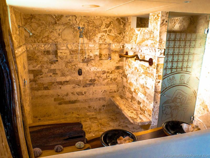 Master bathroom with coral shower, shell faucets, mayan door, + driftwood vanity