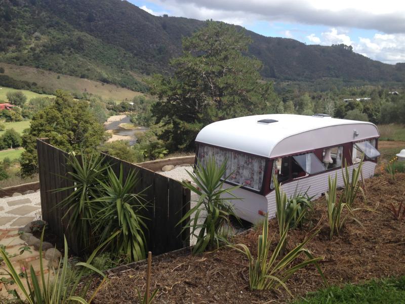 Rosie - our beautifully refurbished vintage caravan. Overlooking the spectacular Kauaeranga river.