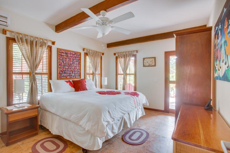 Master Bedroom with King Size Pillow top. AC & Fan