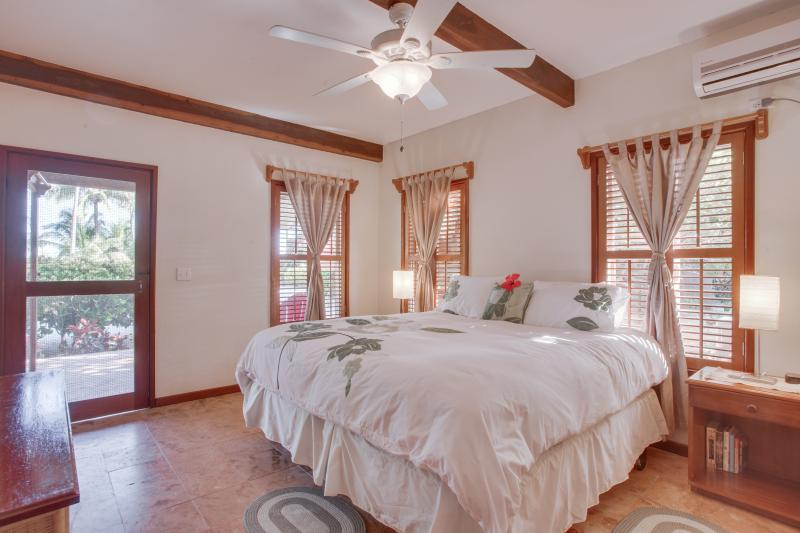 Guest Bedroom with King Size Pillow top. Remote control AC & Fan