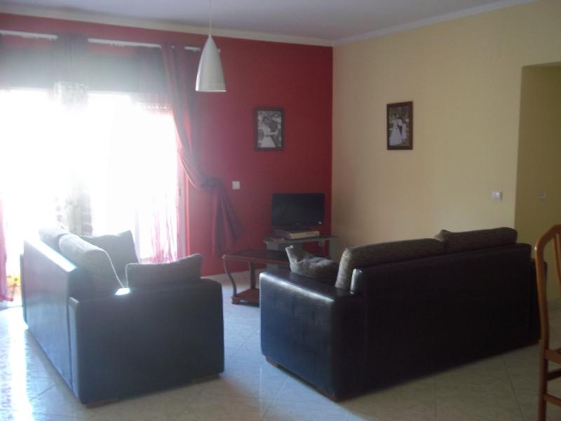 Living room, TV area and WiFi with view to the Avenida de Ceuta. Excellent view to the  main street.