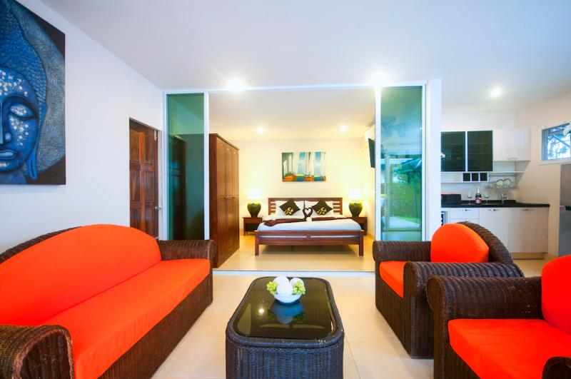 Master bedroom through sliding doors leads onto the open plan living and kitchen area.