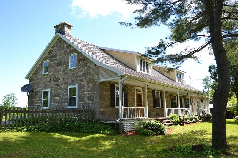 PRIVATE Farmhouse with heated in-ground pool on 100 acres of land.