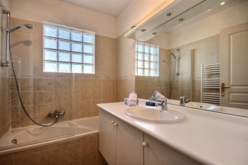 Bath, Overbath Shower, Towel Heater. Separate Toilet.