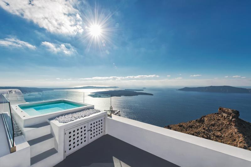 Enjoy the most amazing view from the private terrace with the jacuzzi .