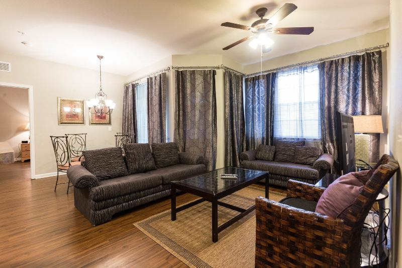 Cozy living room equipped with ceiling fan and 46' HD TV, cable TV, PS3 game console and sofa-bed