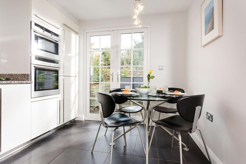 Kitchen leads to secluded and professionally landscaped south facing garden