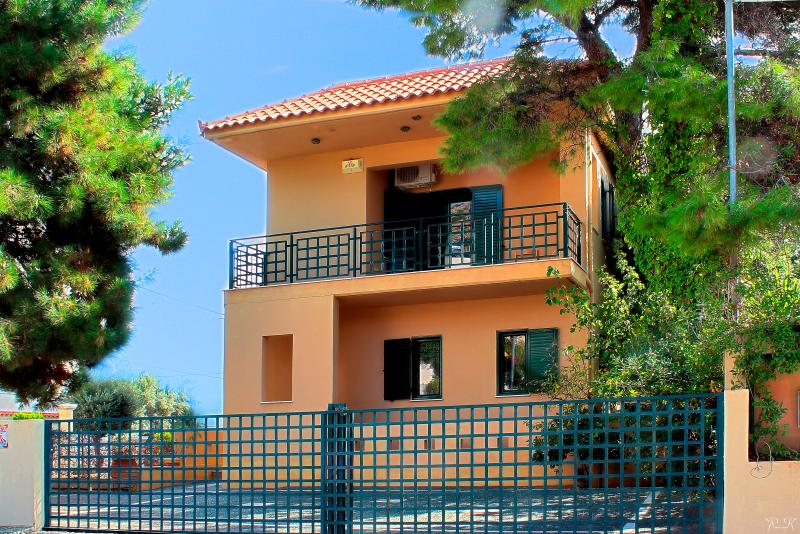 The villa is set on a quiet street under the shade of pine trees