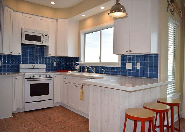 Updated kitchen with beautiful countertops and amazing views.