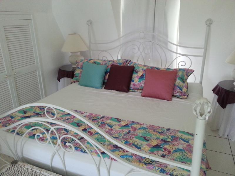 King sized bed on upper floor. A/C & Ceiling fan