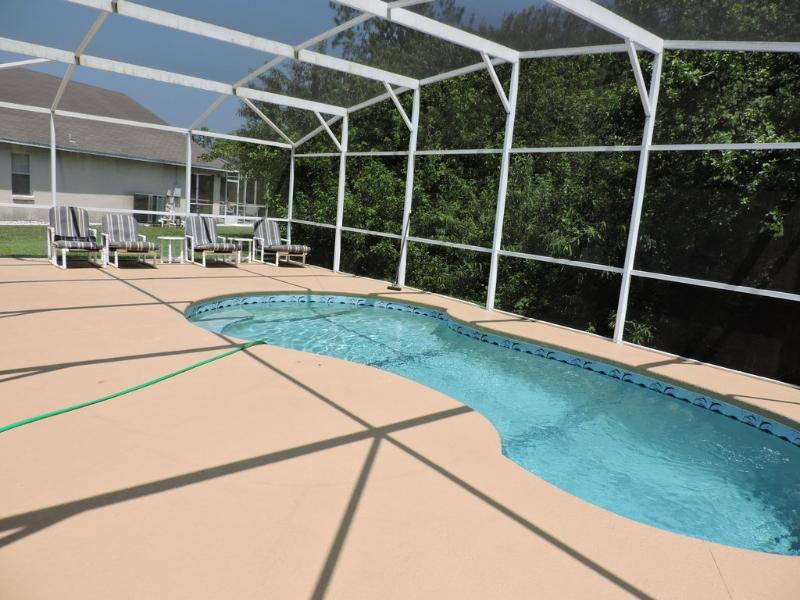Pool with sun loungers.